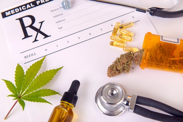 Assorted-cannabis-products-pills-and-cbd-oils-over-medical-prescription